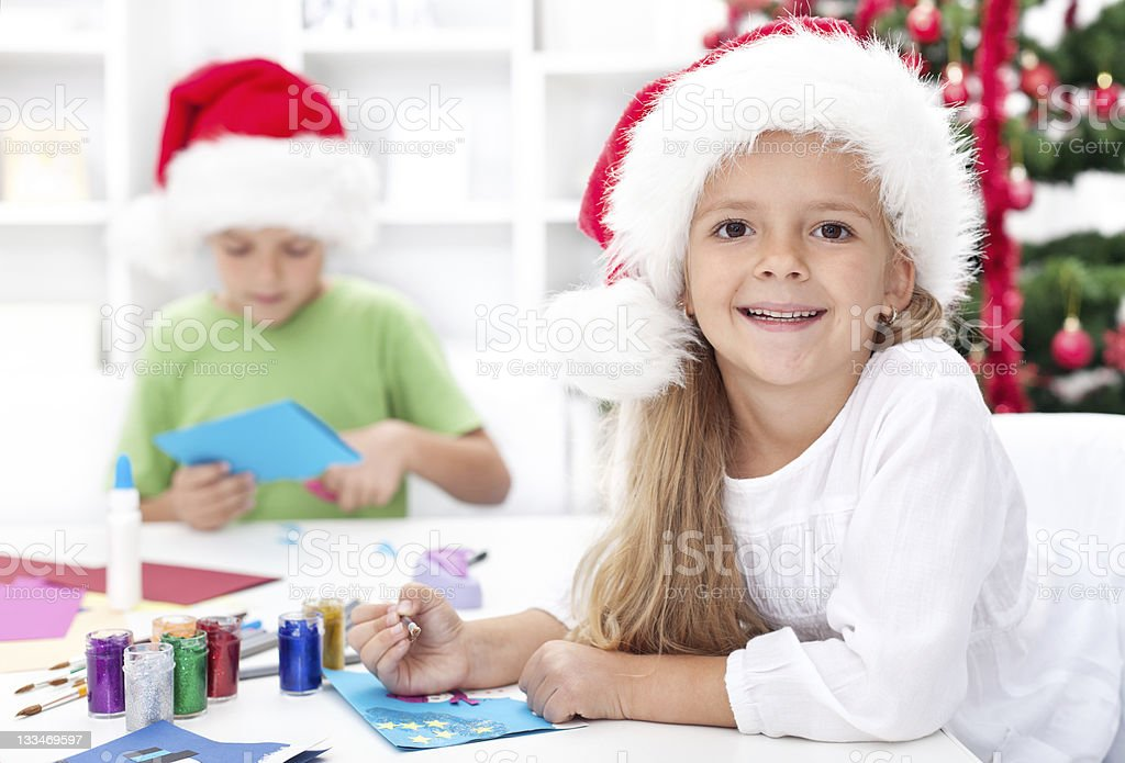 Happy kids making christmas cards royalty-free stock photo