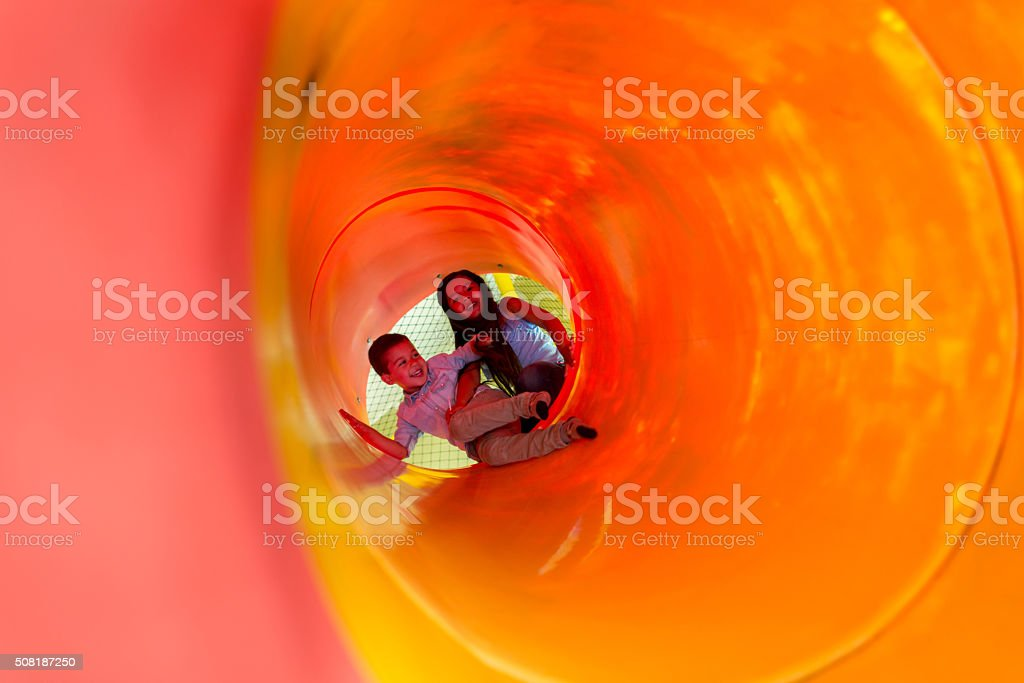 Happy kids playing at the playground stock photo
