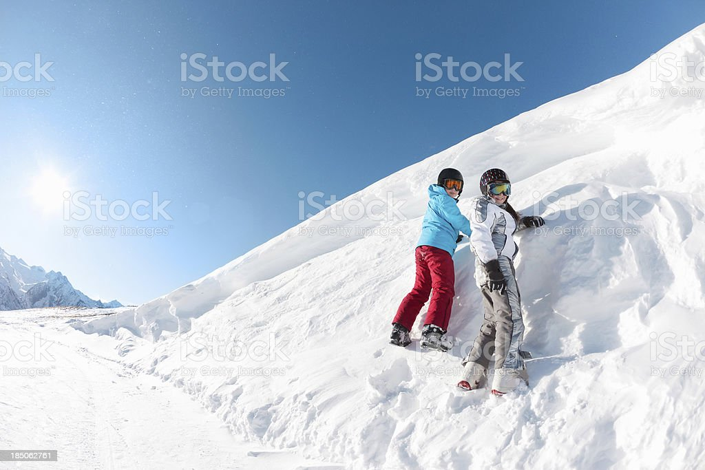 Happy kids playing in the snow royalty-free stock photo