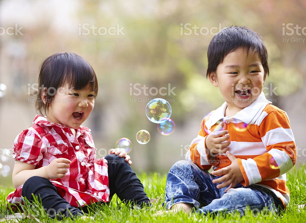 happy kids playing together outdoor royalty-free stock photo