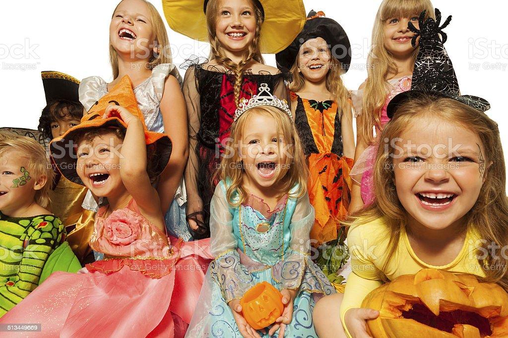 Happy kids wearing Halloween costumes close-up stock photo