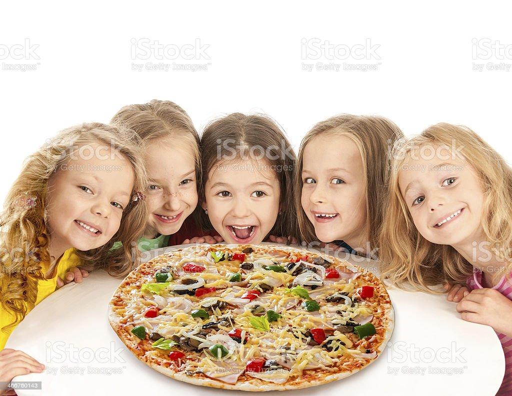 Happy kids with big pizza stock photo