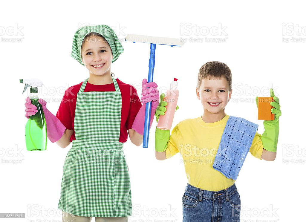 Happy kids with cleaning equipment stock photo