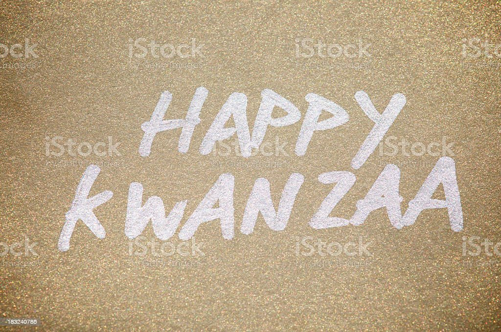 Happy Kwanzaa Message in Silver on Gold Paper stock photo