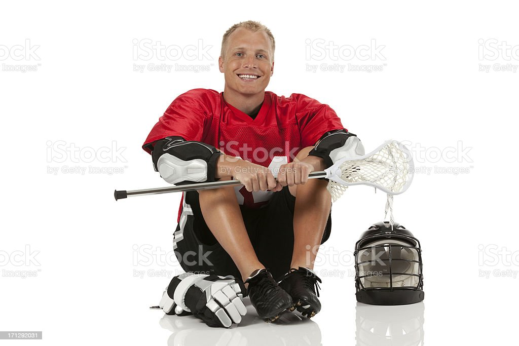 Happy lacrosse player sitting on the floor royalty-free stock photo