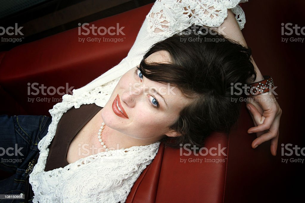 Happy lady on the couch royalty-free stock photo