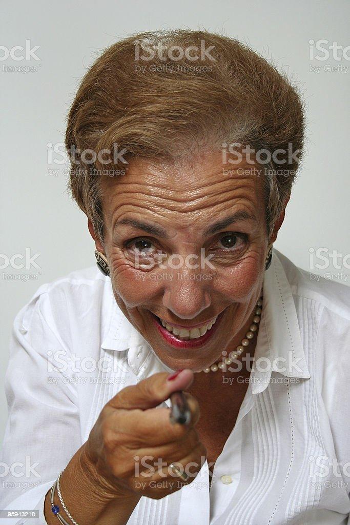 Femme heureuse pointant à vous photo libre de droits