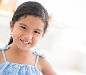 Happy Latin girl smiling