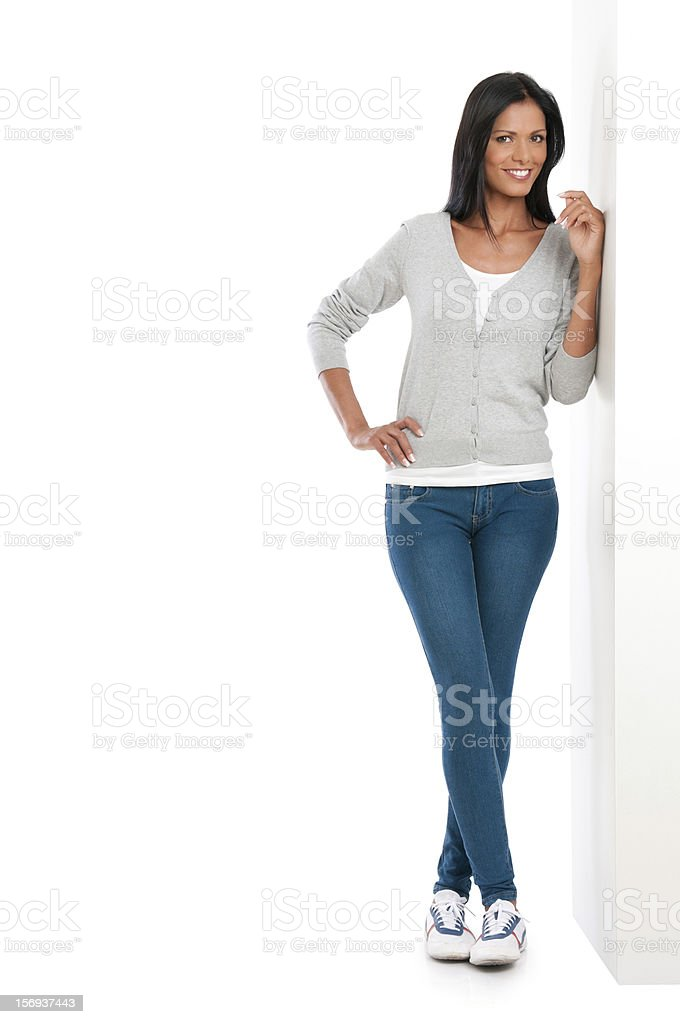 Happy latin girl standing on wall stock photo