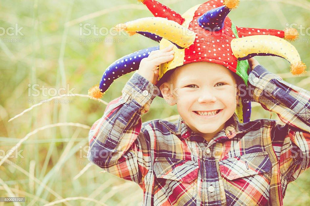 Happy Laughing Boy Wearing Joker Hat stock photo