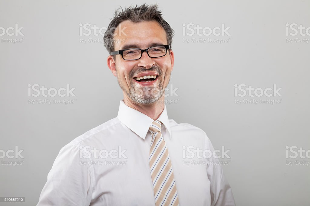 Happy laughing businessman stock photo