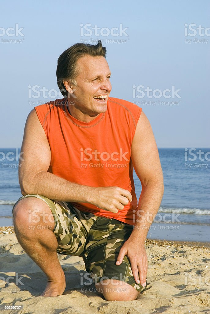 Happy laughing man on beach royalty-free stock photo