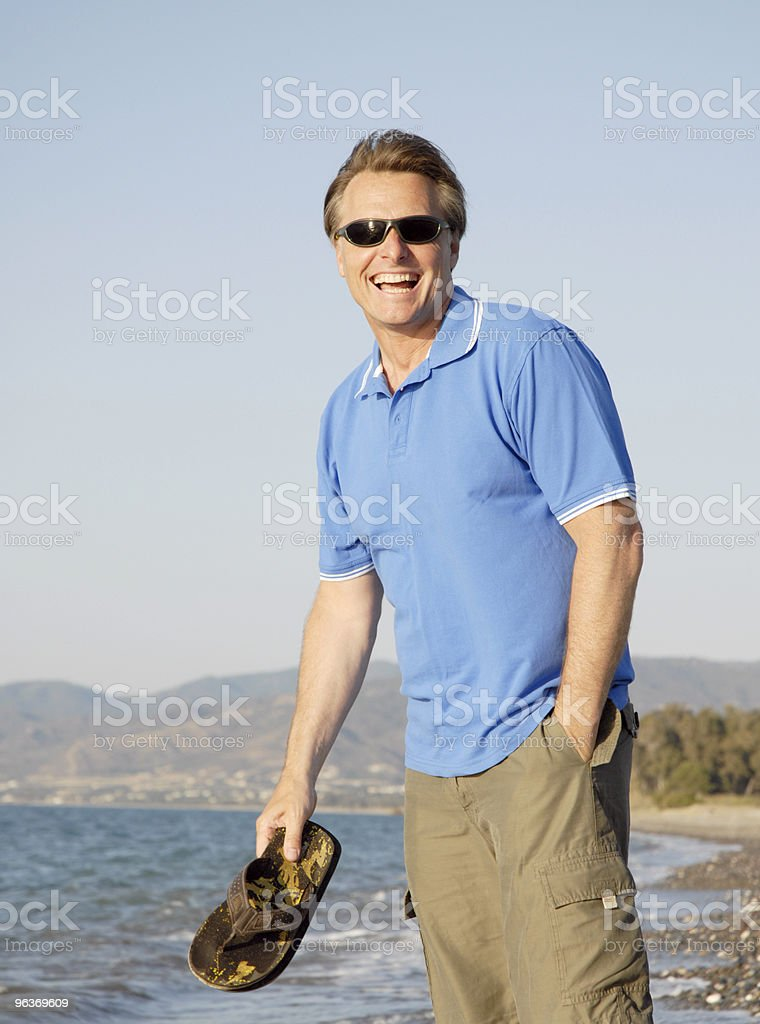 happy laughing man on Cyprus beach royalty-free stock photo