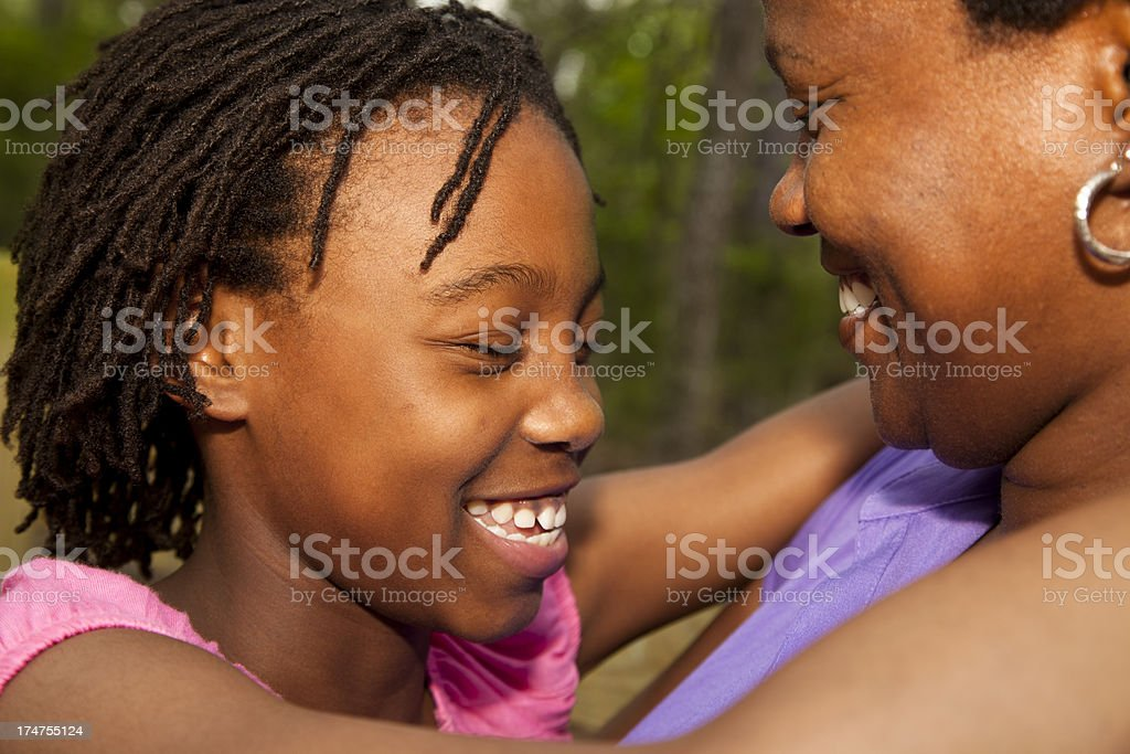 Happy laughing mother and daughter outside royalty-free stock photo