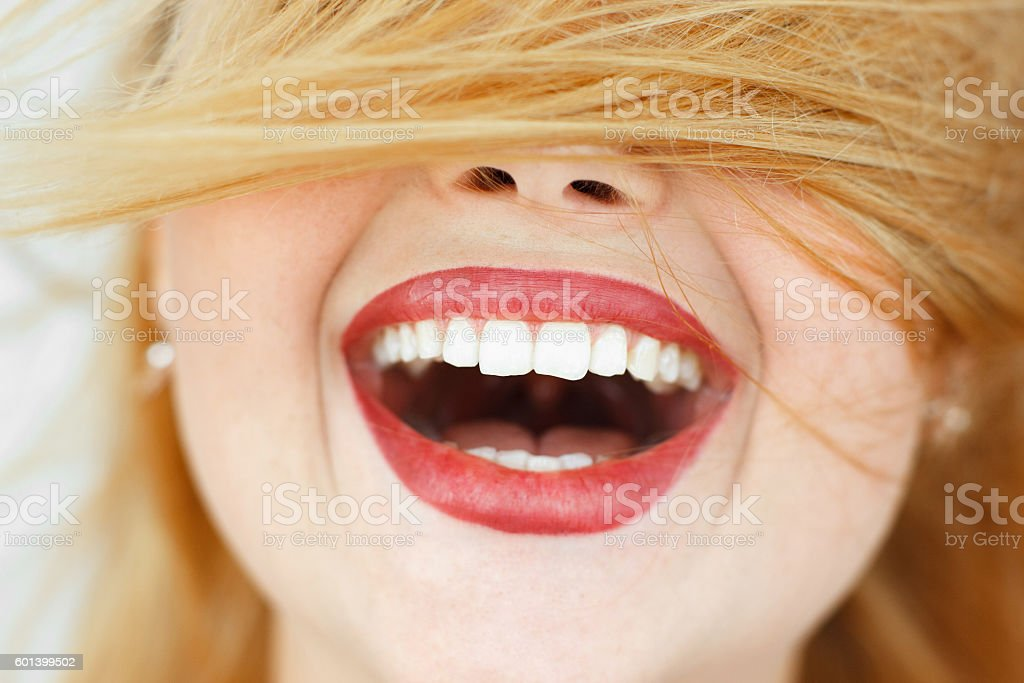 Happy laughing woman with red hair close-up stock photo