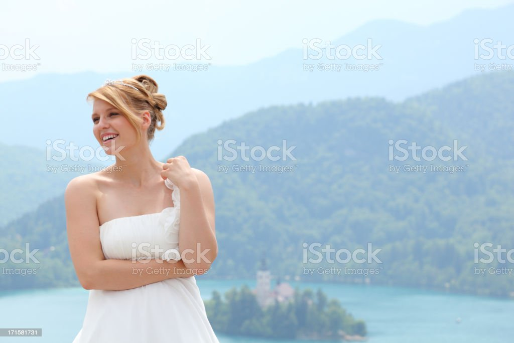 happy laughing young bride in idyllic summer landscape stock photo