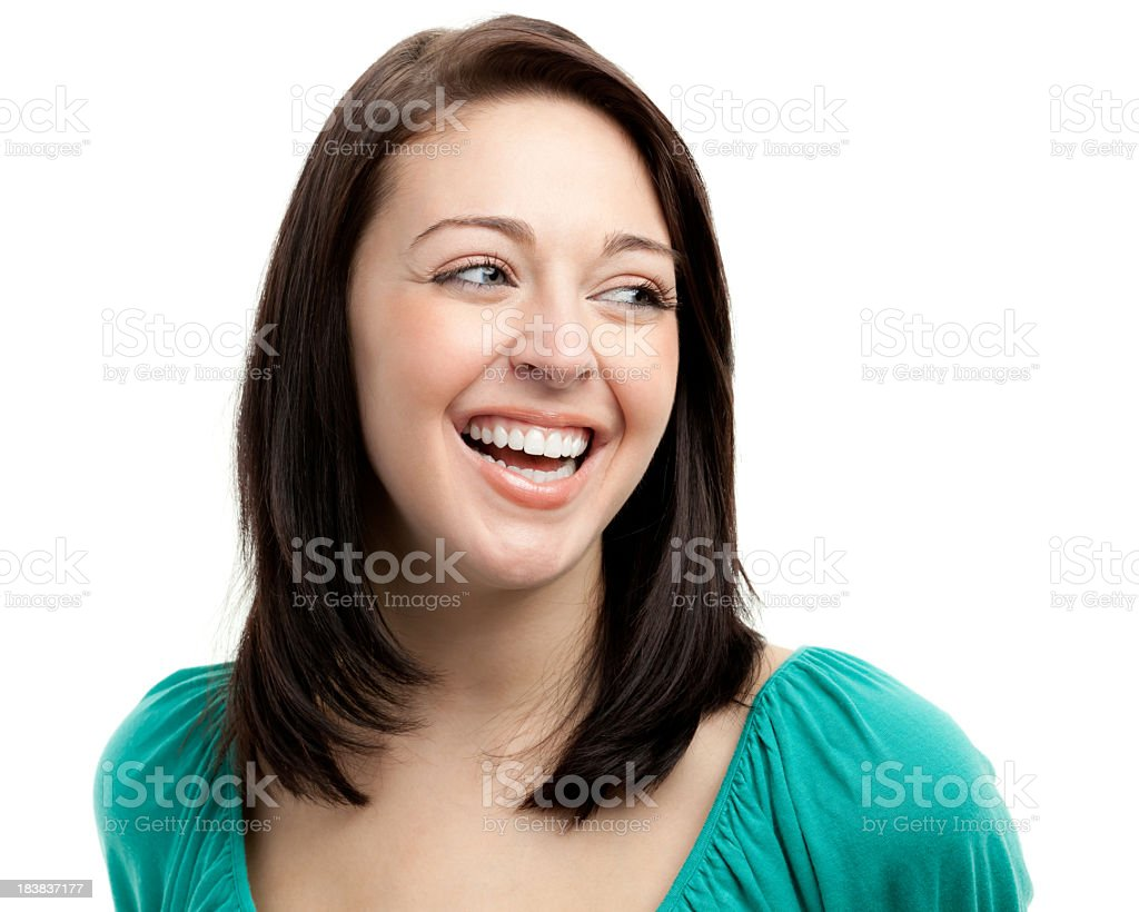 Happy Laughing Young Woman Looking Sideways stock photo