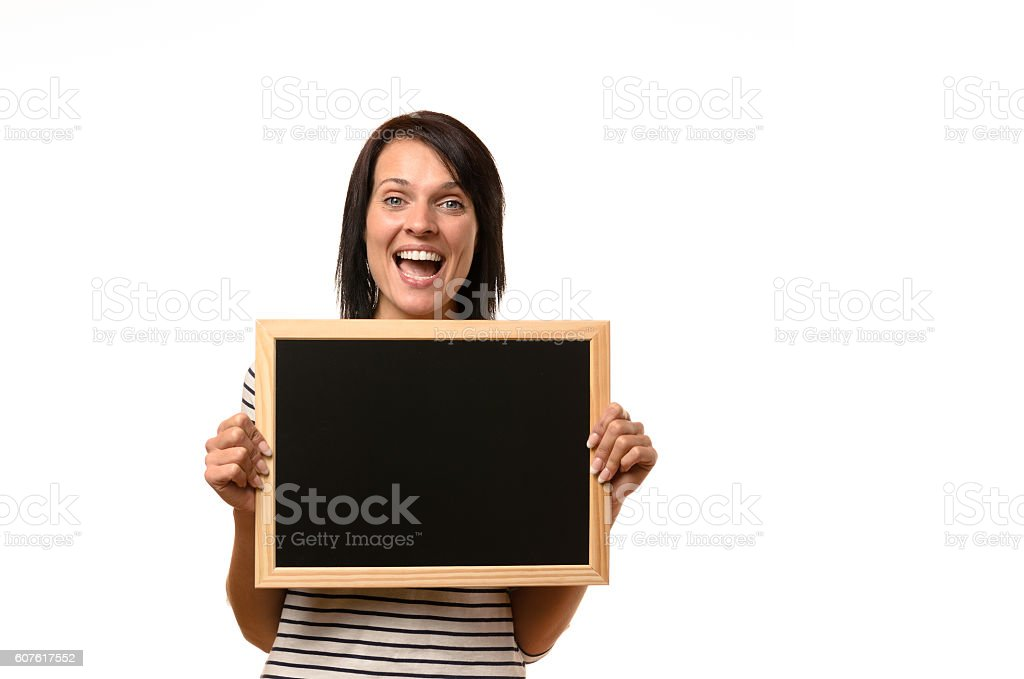 Happy laughing young woman with a blank slate stock photo