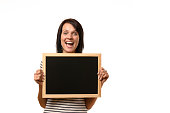 Happy laughing young woman with a blank slate