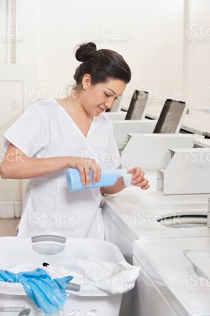 Happy Laundromat Worker stock photo 502197331 | iStock