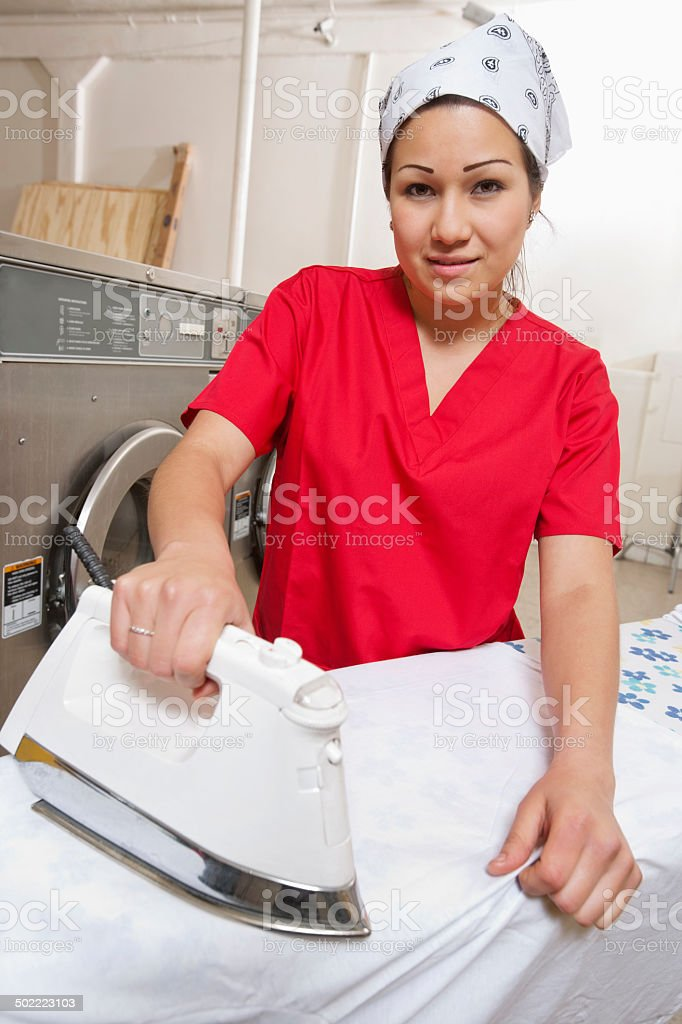 Happy Laundromat Worker Stock Photo | Thinkstock