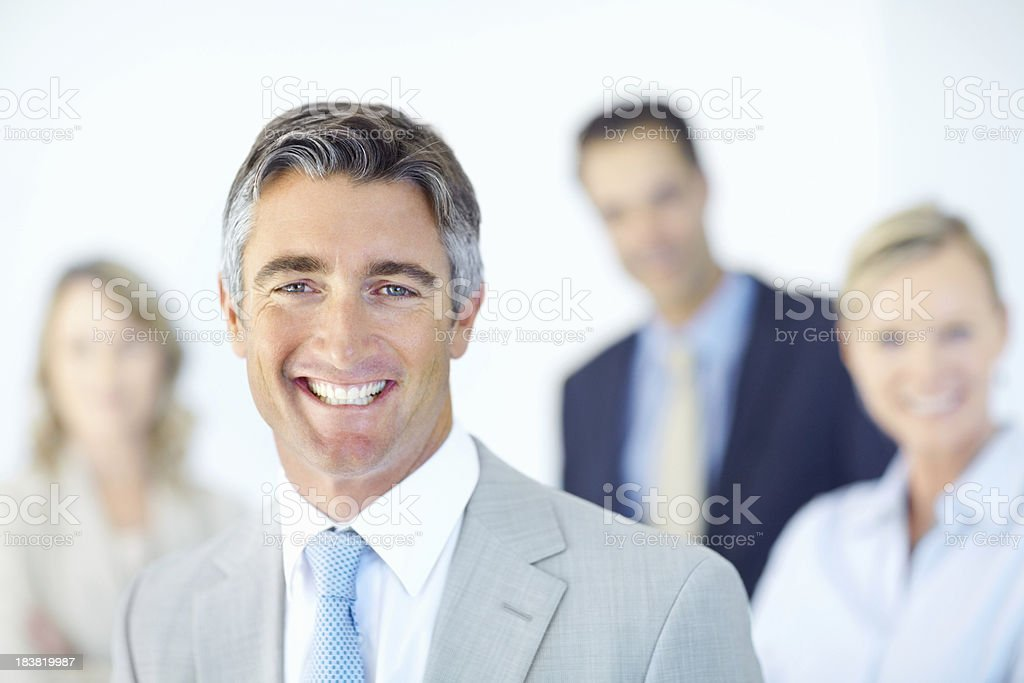 Happy leader with team in background royalty-free stock photo
