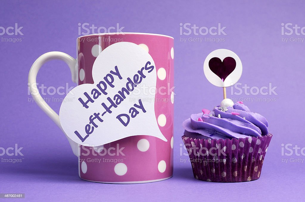 Happy left-Handers Day with coffee mug and cupcake stock photo