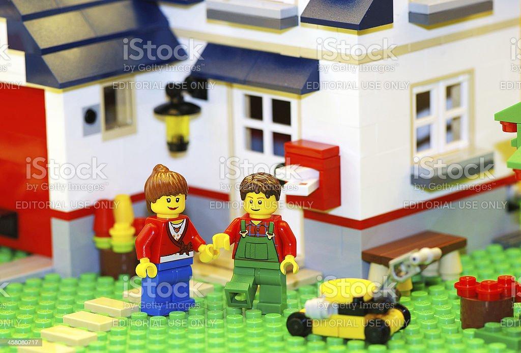 Happy Lego couple with new house stock photo