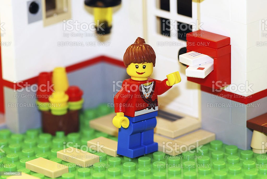 Happy Lego woman checking mail stock photo