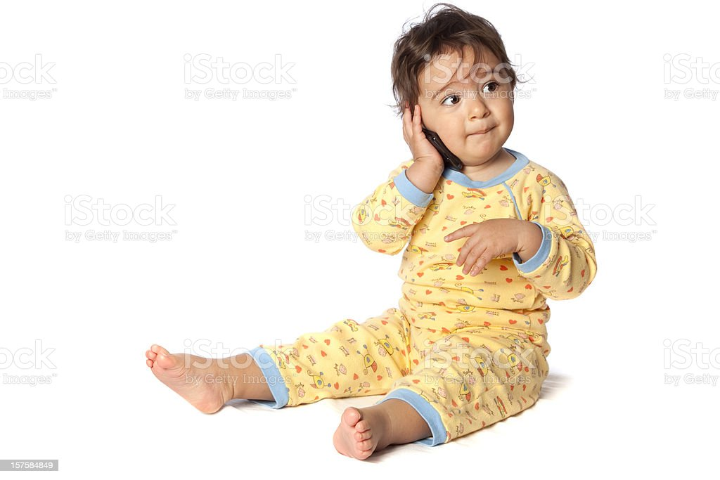 Happy little baby girl talking with cellphone stock photo