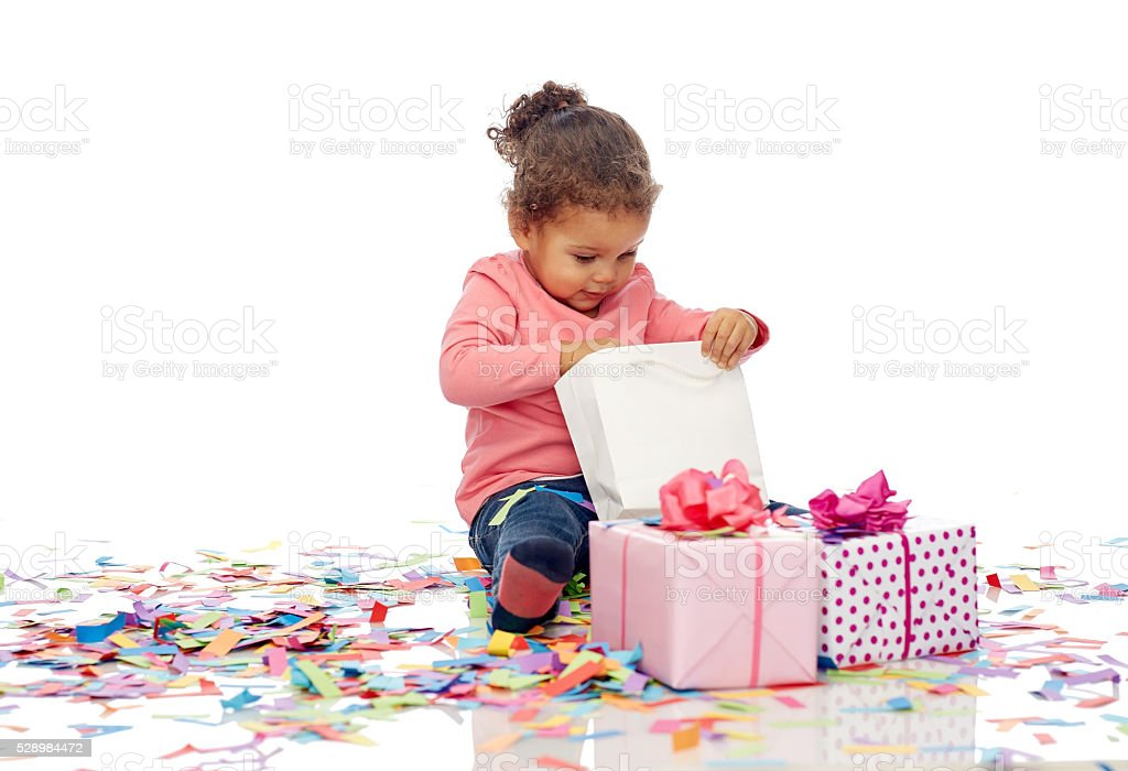 happy little baby girl with birthday presents stock photo