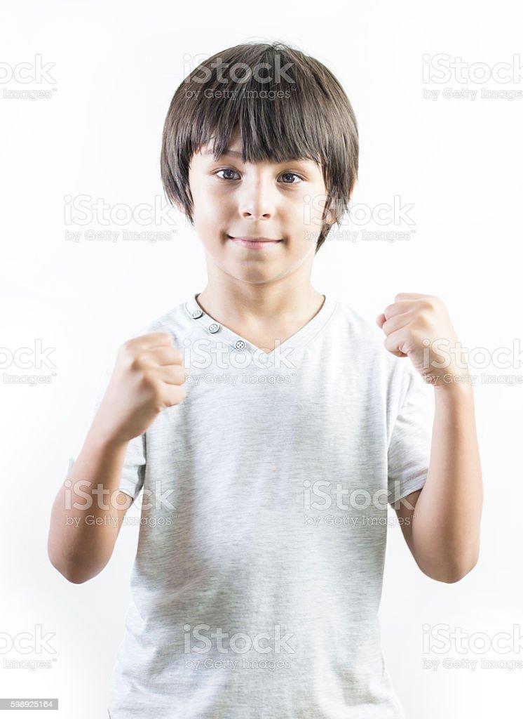 Happy little boy celebrating success Стоковые фото Стоковая фотография