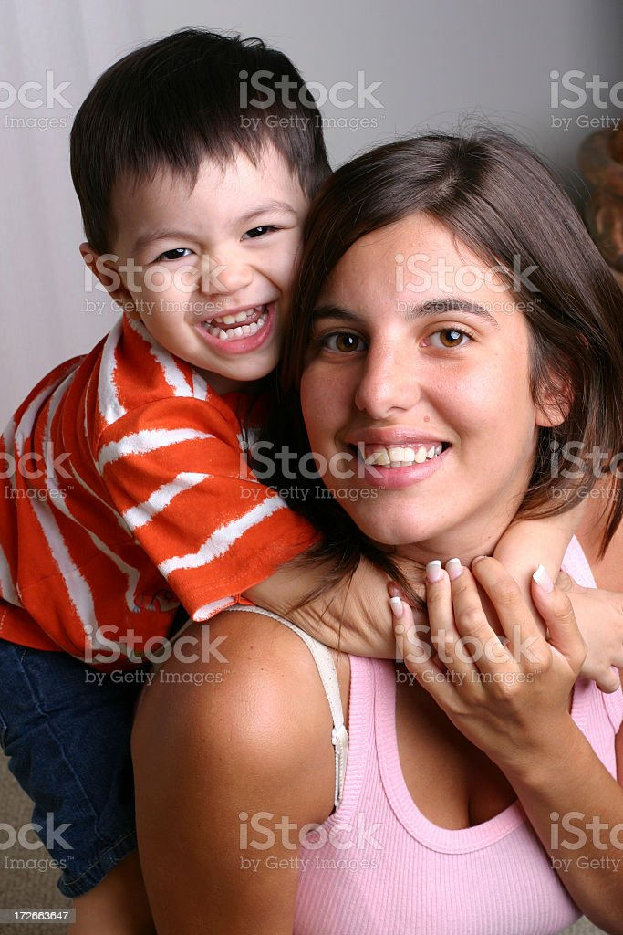 Happy Little boy hugging smiling mom royalty-free stock photo