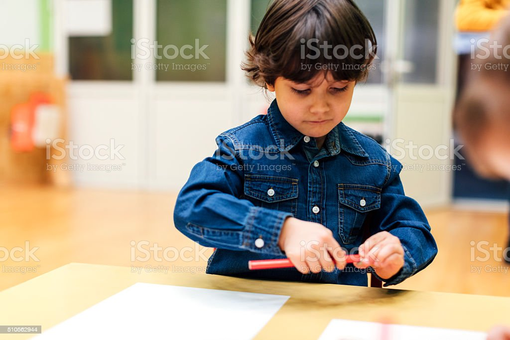 Happy Little Boy in kindergarten stock photo