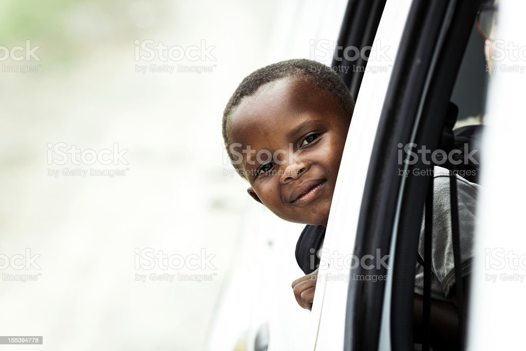 Happy little boy in vehicle stock photo