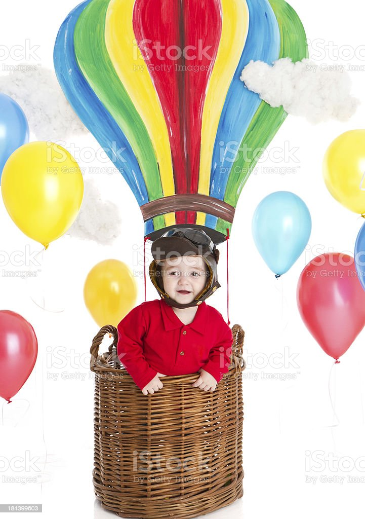 Happy little boy inside a hot air balloon royalty-free stock photo