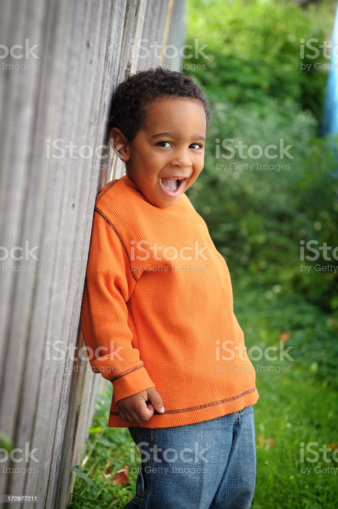 Happy Little Boy Laughing Outside royalty-free stock photo
