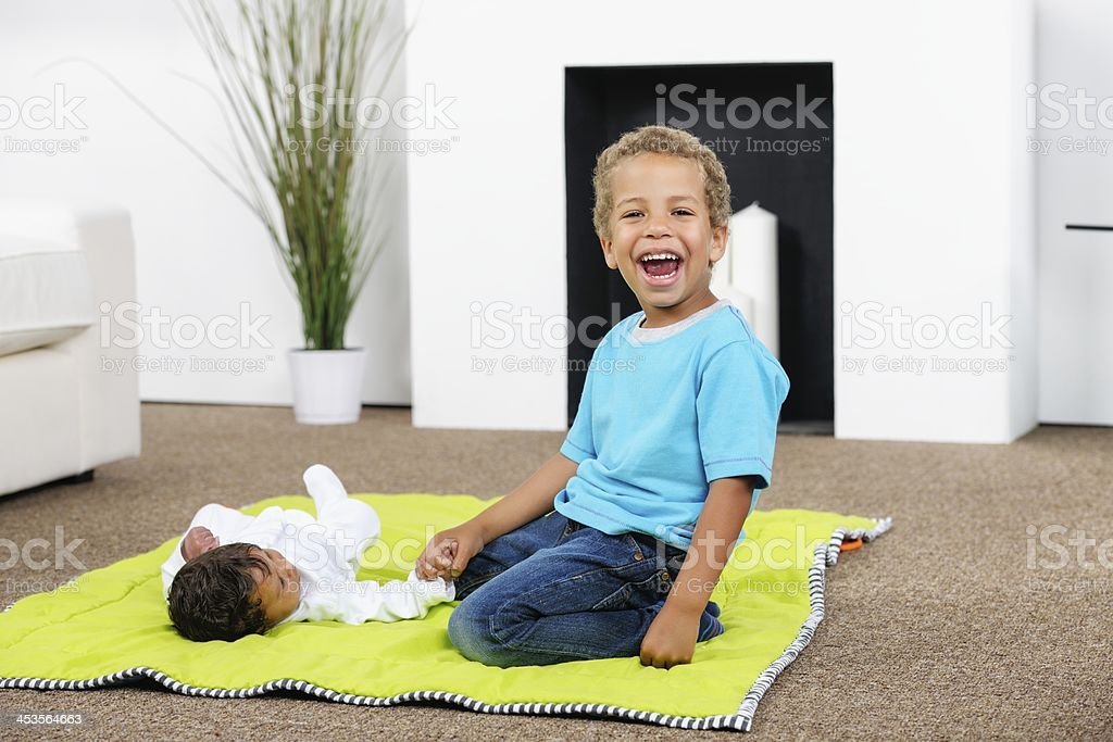 Happy Little Boy Playing With His Baby Sister/ Brother stock photo