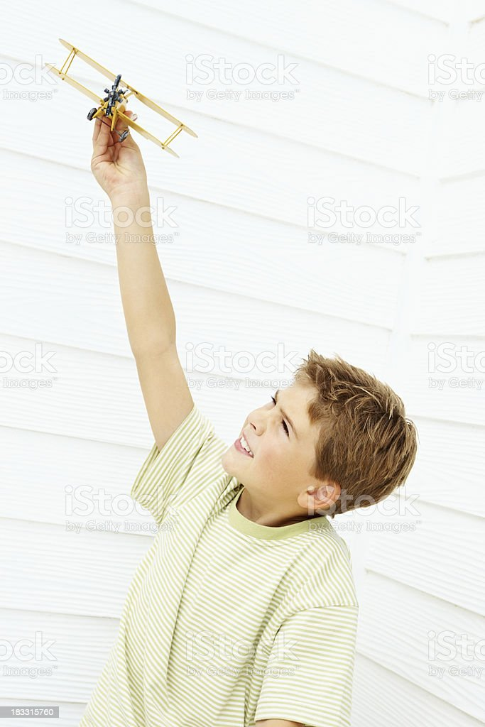 Happy little boy playing with toy airplane royalty-free stock photo