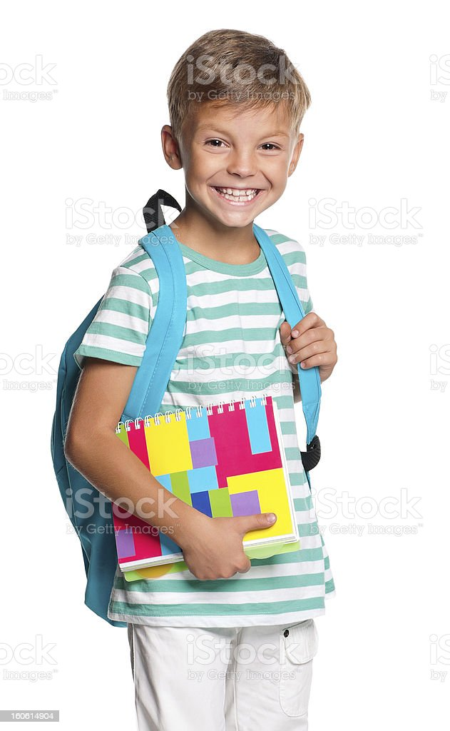 Happy little boy ready for school holding his books stock photo