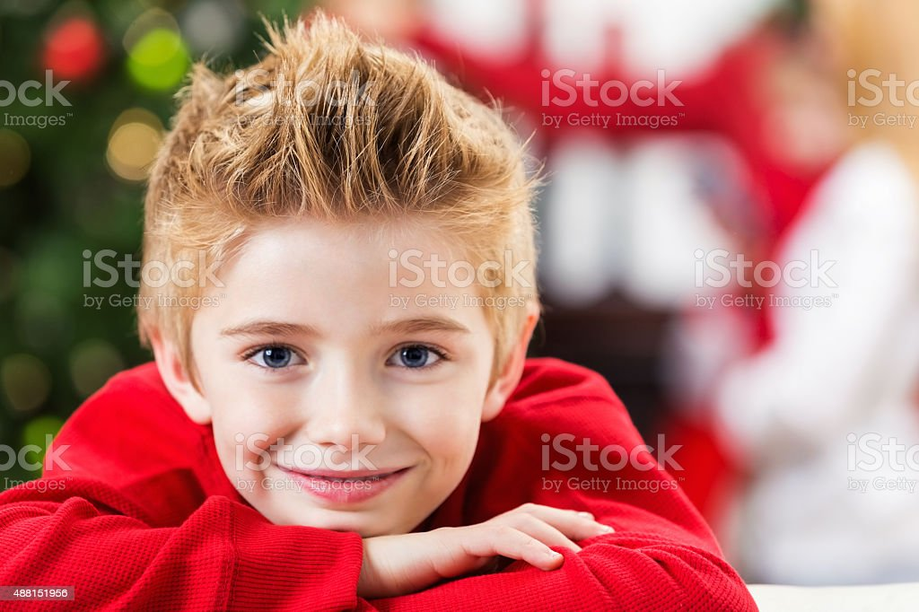 Happy little boy smiling at camera on Christmas day stock photo