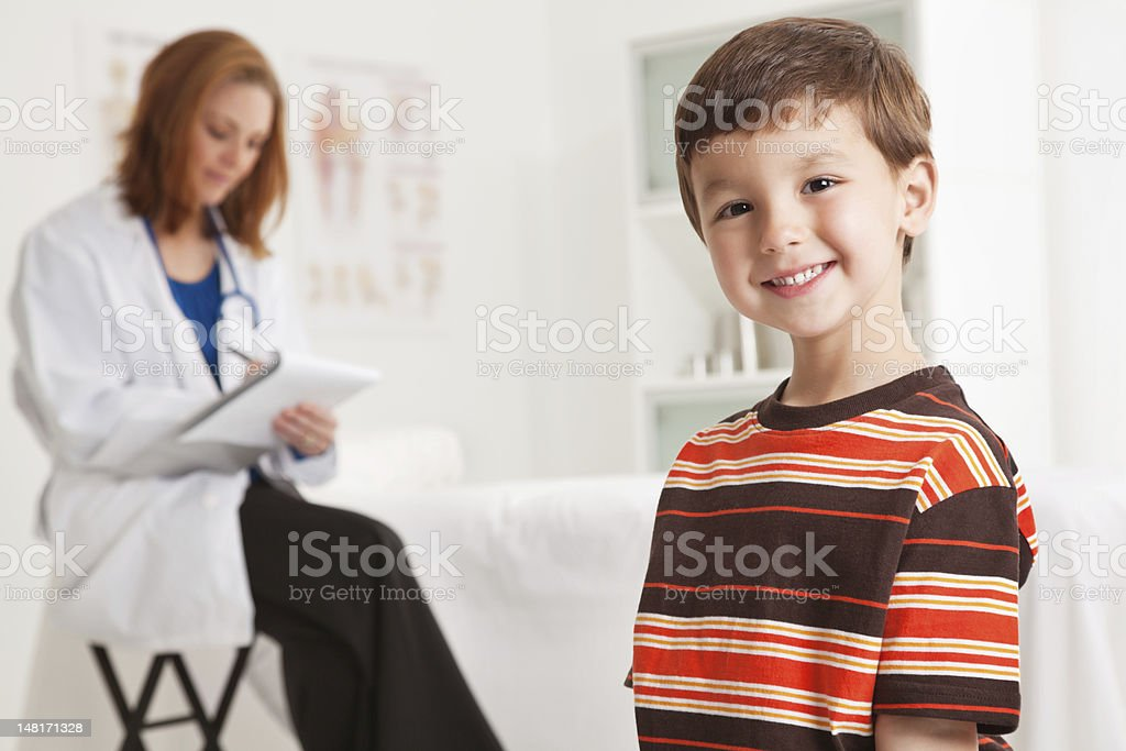 Happy Little Boy Standing in Doctor's Office royalty-free stock photo