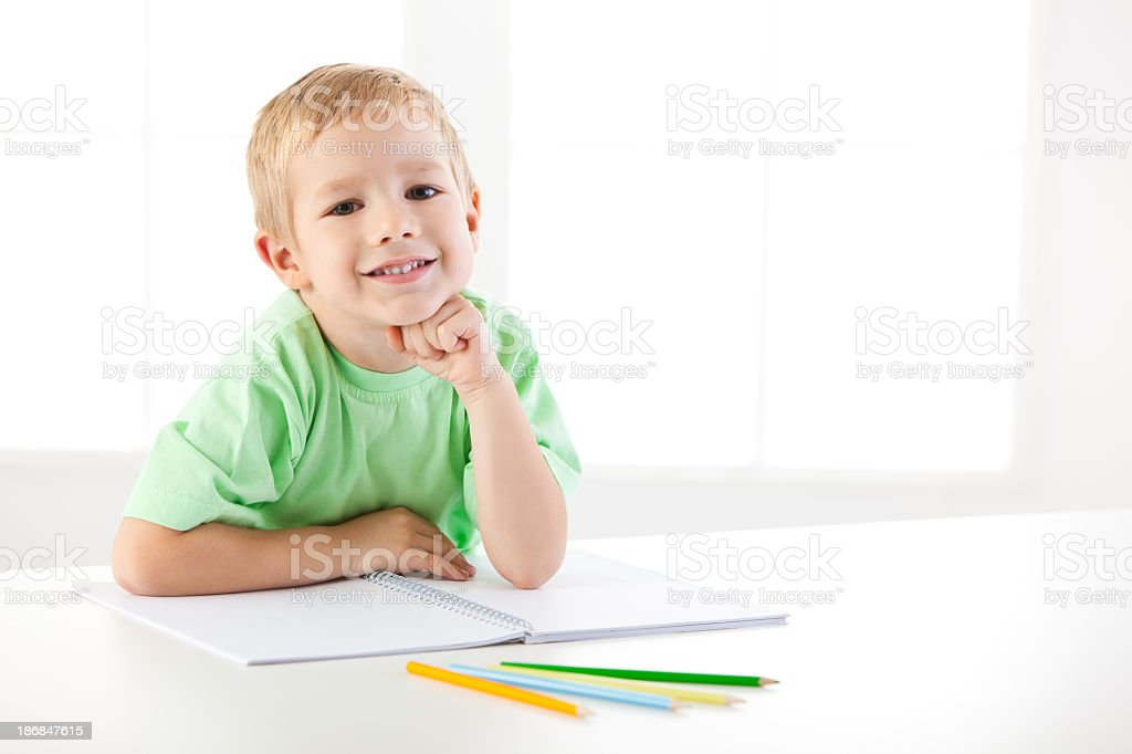 Happy little boy studying royalty-free stock photo