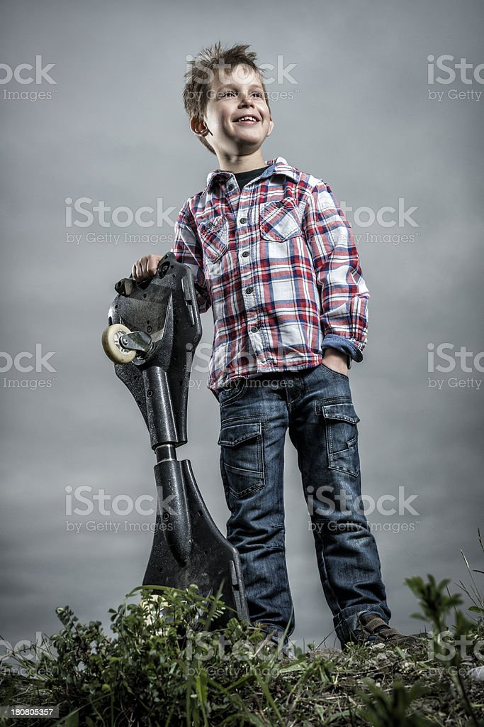 happy little boy with his caster board royalty-free stock photo
