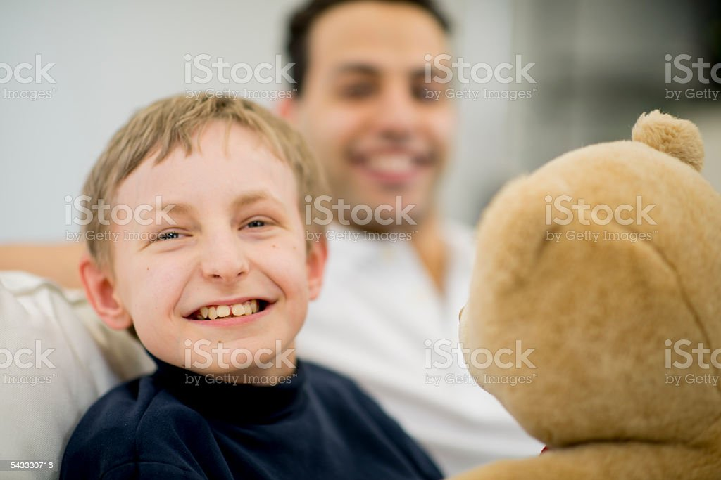 Happy Little Boy with His Stuffed Animal stock photo