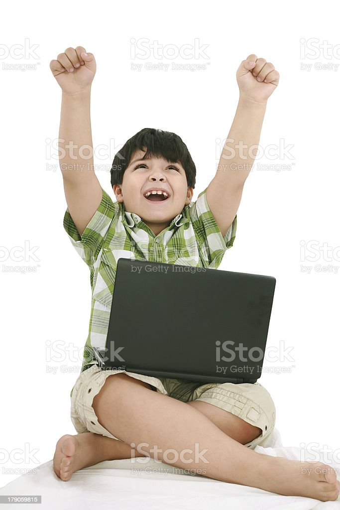 Happy little boy with laptop royalty-free stock photo