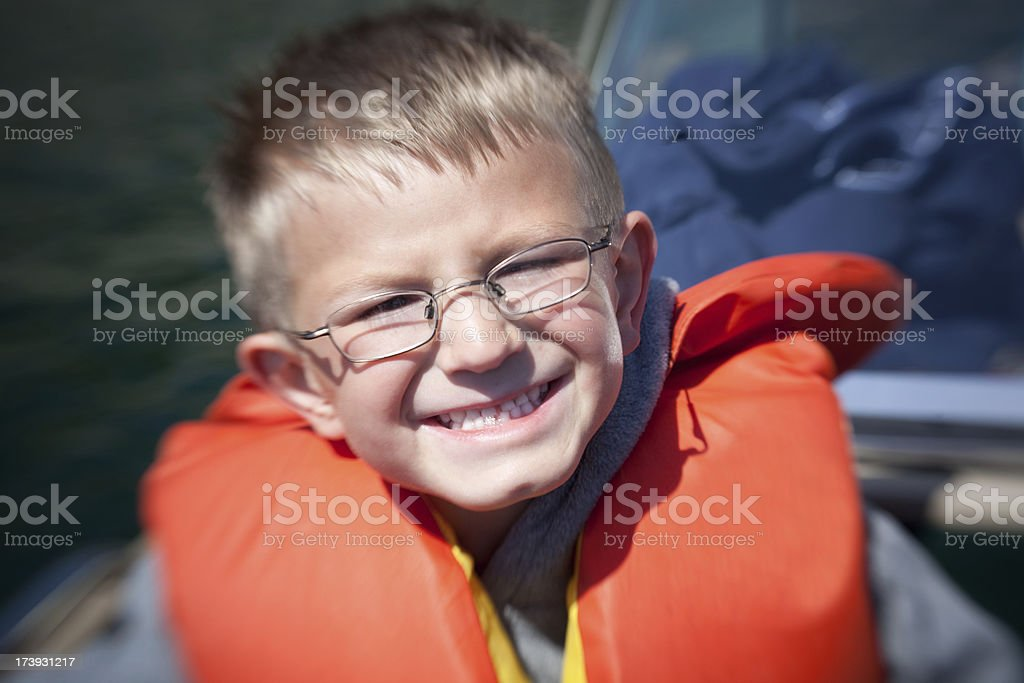 Happy little boy with life jacket royalty-free stock photo
