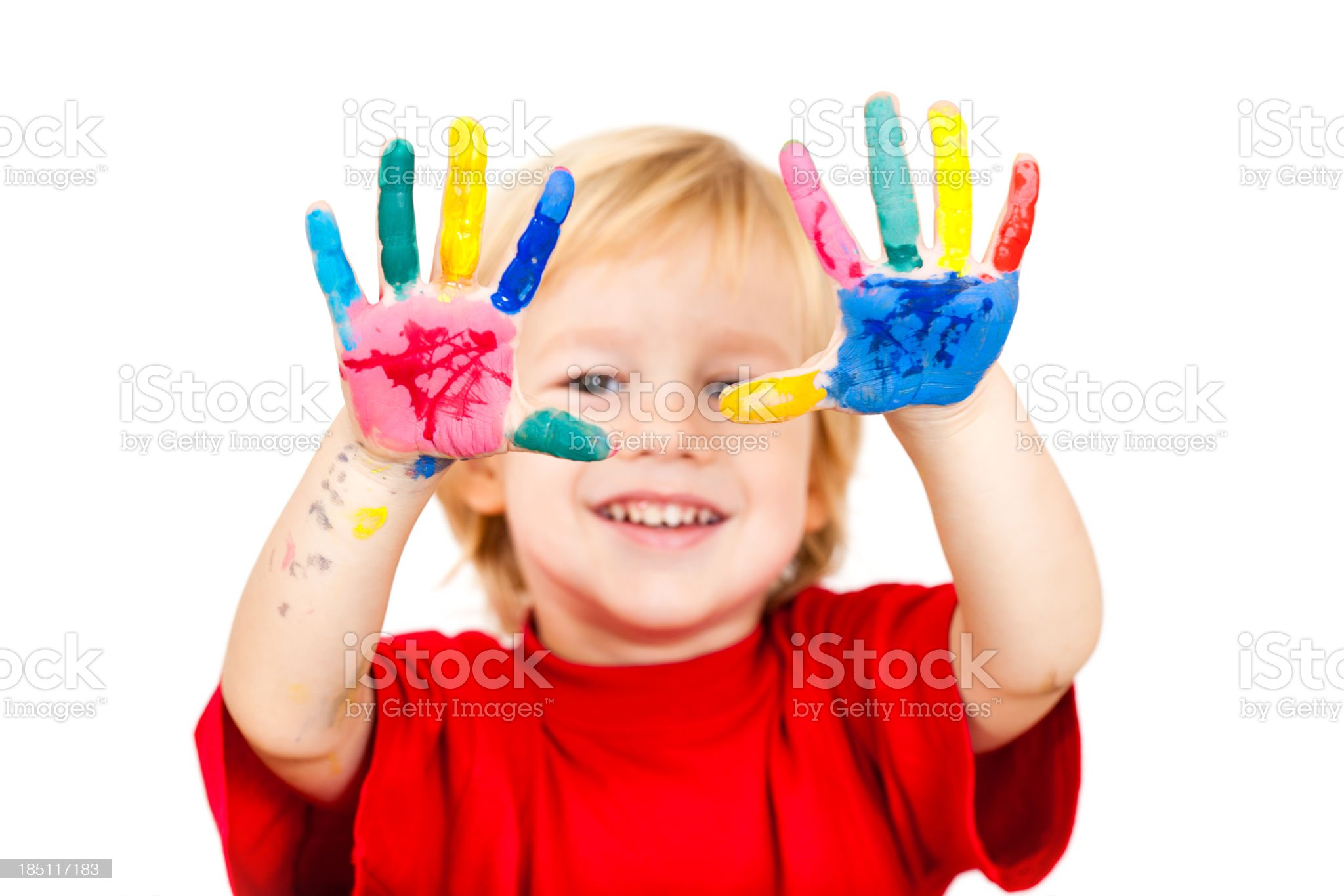 Happy little boy with painted hands royalty-free stock photo