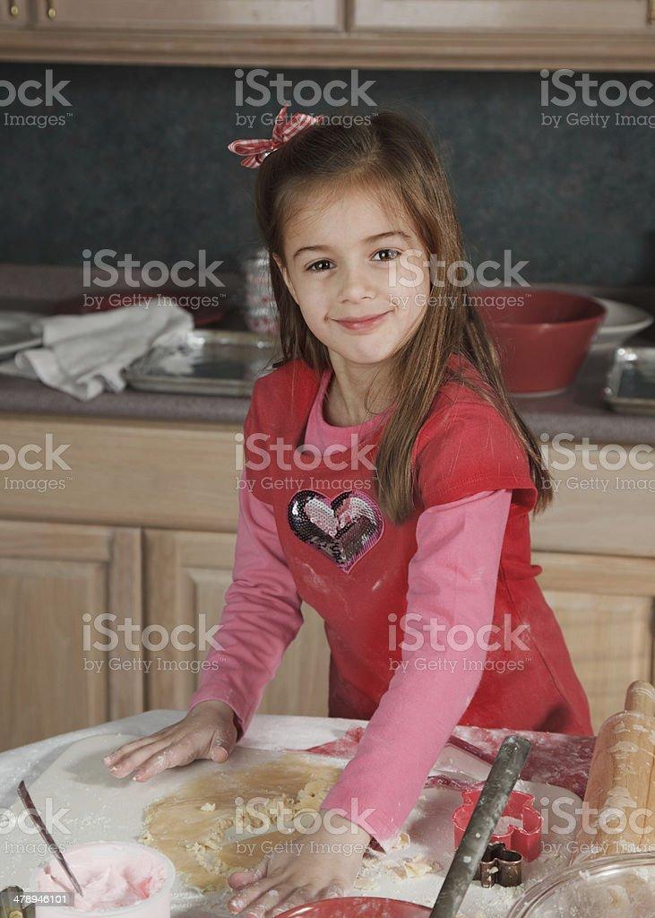 Happy Little Cookie Maker stock photo