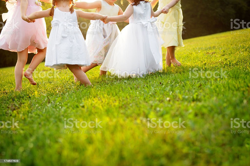 Happy, Little Dancing Princess Girls in Dresses royalty-free stock photo